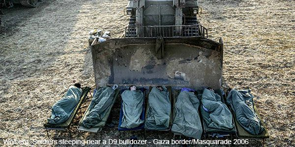 Wolberg_Soldiers sleeping near a D9 bulldozer - Gaza border/Masquarade 2006