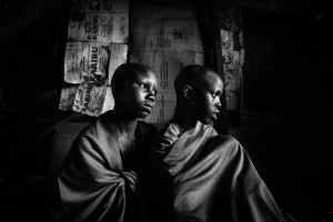 Masai girls Isina & Naserian are sitting in their father's hut the day before their planned circumcision.